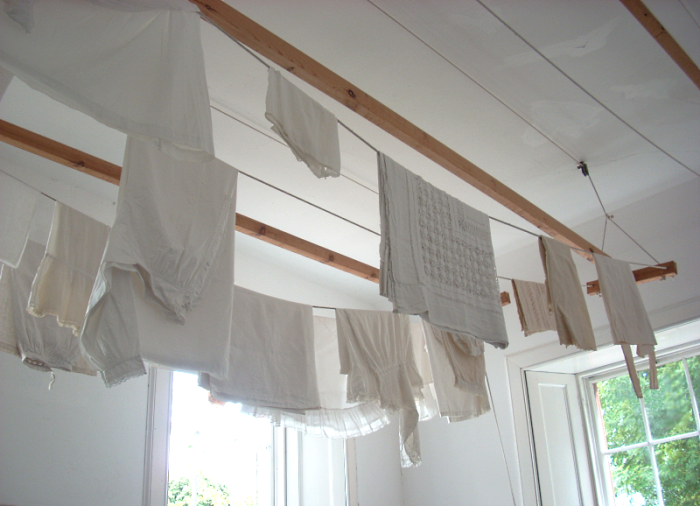 laundry drying on ceiling rack
