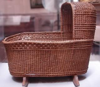 wicker rocking cradle with hood