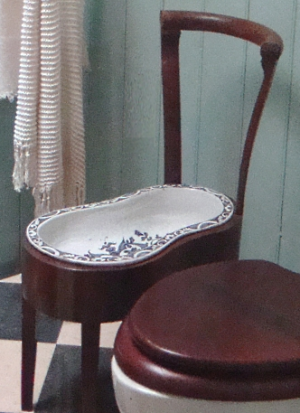 antique porcelain bidet in wooden chair frame