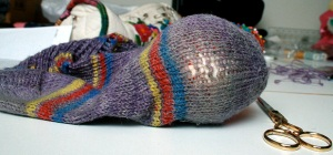 sock with darning ball inside