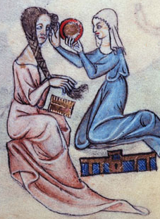 Medieval lady hold H comb as maid helps with her hair
