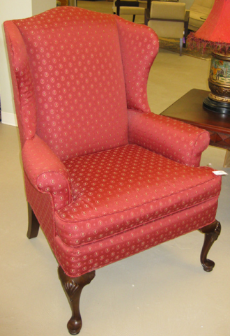 wing chair upholstered in red
